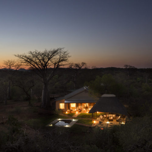 Safari bush house at night