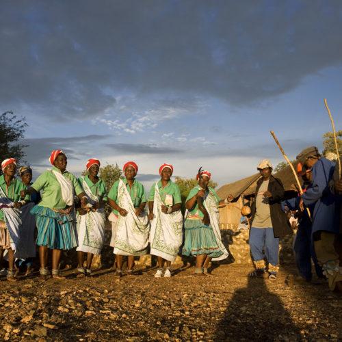 African community performing members dancing