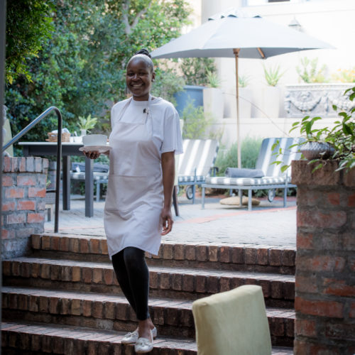 Cape Town guest house courtyard staff